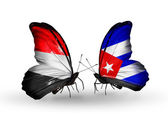 Butterflies with Yemen and  Cuba flags on wings — Stockfoto