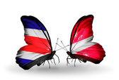 Borboletas com costa rica e bandeiras da letónia em asas — Foto Stock