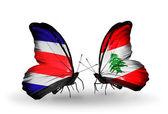 Farfalle con costa rica e libano bandiere sulle ali — Foto Stock