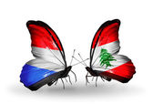 Butterflies with Luxembourg and  Lebanon flags on wings — Foto Stock