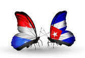 Butterflies with Luxembourg and  Cuba flags on wings — Foto Stock