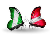Butterflies with Nigeria and  Latvia flags on wings — Foto Stock