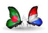 Farfalle con bandiere bangladesh e lussemburgo sulle ali — Foto Stock