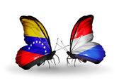 Butterflies with Venezuela and Luxembourg flags on wings — ストック写真