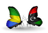 Butterflies with Gabon and Libya flags on wings — Foto Stock