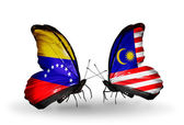 Butterflies with Venezuela and Malaysia flags on wings — Foto Stock