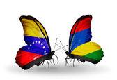 Vlinders met venezuela en mauritius vlaggen op vleugels — Stockfoto