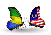Butterflies with Gabon and Malaysia flags on wings — Stock Photo