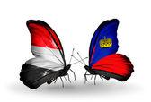 Butterflies with Yemen and  Liechtenstein flags on wings — Foto Stock