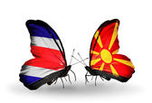 Butterflies with Costa Rica and Macedonia flags on wings — Foto Stock