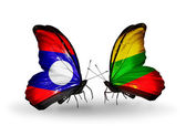 Butterflies with Laos and Lithuania flags on wings — Stock Photo