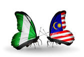 Mariposas con banderas de nigeria y malasia en alas — Foto de Stock