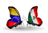 Butterflies with Venezuela and Mexico flags on wings — Stock Photo
