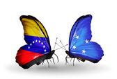 Borboletas com venezuela e micronésia bandeiras sobre asas — Foto Stock