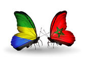 Butterflies with Gabon and Morocco flags on wings — Foto Stock