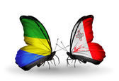 Farfalle con bandiere gabon e malta sulle ali — Foto Stock