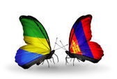 Butterflies with Gabon and Mongolia flags on wings — Zdjęcie stockowe