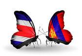Mariposas con costa rica y banderas de mongolia en alas — Foto de Stock