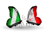 Butterflies with Nigeria and Malta flags on wings — Stock Photo