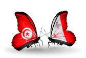 Motýli s Tuniskem a malta vlajky na křídlech — Stock fotografie