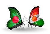 Mariposas con bangladesh y níger banderas en las alas — Foto de Stock