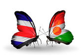 Butterflies with Costa Rica and  Niger flags on wings — Stock Photo