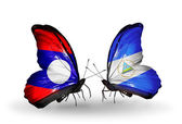 Butterflies with Laos and Nicaragua  flags on wings — Stock Photo