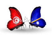 Butterflies with Tunisia and Nauru flags on wings — Stock Photo