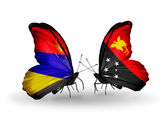 Butterflies with Armenia and  Papua New Guinea flags on wings — Stok fotoğraf