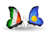 Butterflies with Ireland and Palau flags on wings — Stock Photo