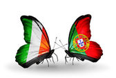 Butterflies with Ireland and Portugal flags on wings — Stock Photo