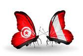 翼にチュニジアとペルーのフラグと蝶 — ストック写真
