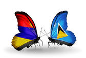 Butterflies with Armenia and  Saint Lucia flags on wings — Stock Photo