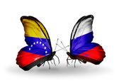 Borboletas com bandeiras de venezuela e a Rússia sobre asas — Fotografia Stock
