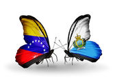 Butterflies with Venezuela and San Marino flags on wings — ストック写真
