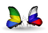 Butterflies with Gabon and Russia flags on wings — 图库照片