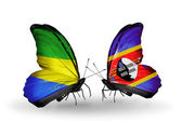 Butterflies with Gabon and Swaziland flags on wings — Stock Photo