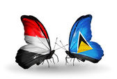 Butterflies with Yemen and  Saint Lucia flags on wings — 图库照片