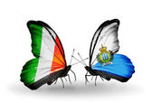 Butterflies with Ireland and San Marino flags on wings — Stock Photo