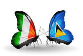 Butterflies with Ireland and  Saint Lucia flags on wings — Stock Photo