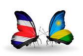 翼の上のルワンダ フラグとコスタリカの蝶 — ストック写真