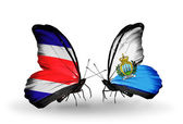 Butterflies with Costa Rica and  San Marino flags on wings — ストック写真