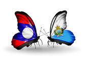 Butterflies with Laos and San Marino flags on wings — Stock Photo