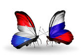 Butterflies with Luxembourg and Russia flags on wings — Stock Photo