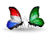 Butterflies with Luxembourg and Saudi Arabia flags on wings — Stock Photo