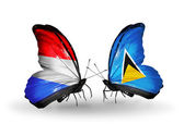 Butterflies with Luxembourg and Saint Lucia flags on wings — 图库照片