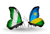 Butterflies with Nigeria and Rwanda flags on wings — Stock Photo