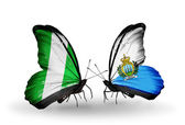Butterflies with Nigeria and San Marino flags on wings — Stock Photo
