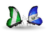 Butterflies with Nigeria and Salvador flags on wings — Stock Photo