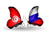Butterflies with Tunisia and Russia flags on wings — 图库照片